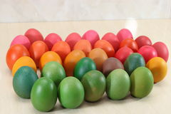 Colorful easter eggs on white marble background with copy space. royalty free stock images