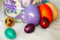 Colorful Easter eggs with white pictures Royalty Free Stock Images