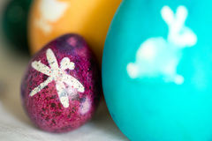 Colorful Easter eggs with white pictures Stock Photos