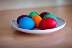 Colorful easter eggs on white plate Royalty Free Stock Photos
