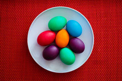 Colorful easter eggs on white plate Stock Images