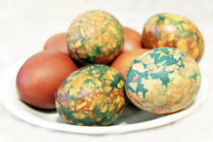 Colorful Easter Eggs On White Plate Placed By Heap Stock Images