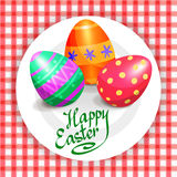 Colorful Easter eggs on white plate and red tablecloth Royalty Free Stock Photography
