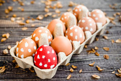 Colorful easter eggs with white points in a box on a table Royalty Free Stock Photo