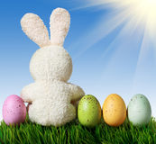 Colorful easter eggs and white rabbit Stock Photos