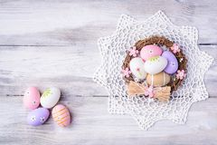 Colorful Easter eggs with white serviette and nest Royalty Free Stock Photo
