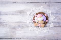 Colorful Easter eggs with white serviette and nest Royalty Free Stock Image