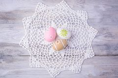 Colorful Easter eggs with white serviette Stock Image