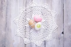 Colorful Easter eggs with white serviette Stock Images