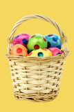 Colorful easter eggs in a wicker basket Stock Images