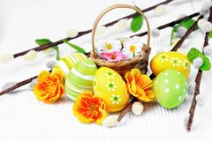 Colorful Easter eggs and willow branches Stock Images