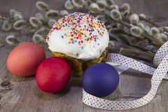 Colorful Easter eggs with willow twig stock photos