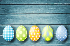 Colorful easter eggs  on wood background. Stock Photo