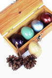 Colorful easter eggs in wood box on white background, Stock Photo