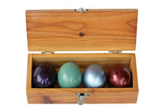 Colorful easter eggs in wood box on white background. Stock Photo