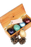 Colorful easter eggs in wood box on white background. Stock Photography