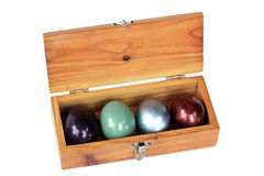 Colorful easter eggs in wood box on white background. Royalty Free Stock Photography
