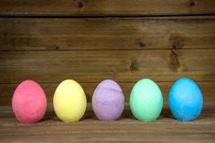 Colorful Easter eggs on wood Royalty Free Stock Images