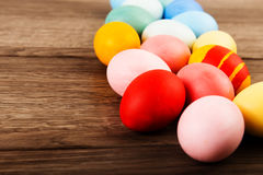 Colorful easter eggs on wood table background Royalty Free Stock Image