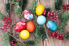 Colorful Easter eggs on wooden background Stock Photo