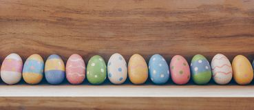 Colorful easter eggs on wooden background with copy space stock photography