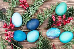 Colorful Easter eggs on wooden background Royalty Free Stock Photos