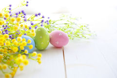Colorful Easter eggs on wooden background. Stock Photography