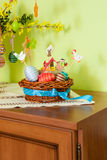 Colorful easter eggs in wooden basket Royalty Free Stock Image