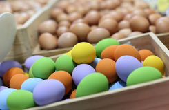 Colorful Easter eggs in the wooden box in blur background Stock Photos