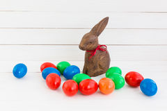 Colorful easter eggs and wooden hare Stock Photos