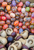Colorful easter eggs and wooden nutcrackers in fair Royalty Free Stock Photos