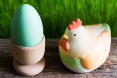 Colorful easter eggs on wooden plank and green grass stock image