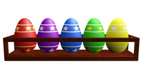 Colorful Easter Eggs in a Wooden Rack Stock Image