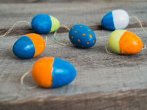 Colorful easter eggs on a wooden table Stock Photo