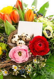 Colorful easter flowers bouquet, eggs decoration Stock Image