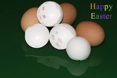 Easter greetings with shattered eggshells Stock Photography