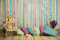 Colorful easter home interior with striped background Stock Images