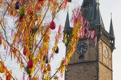 Colorful Easter maypole in front of clock tower royalty free stock photos