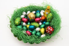 Colorful Easter nest. With many different eggs stock images