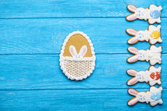 Colorful easter rabbit cookies on blue wooden background Stock Photos