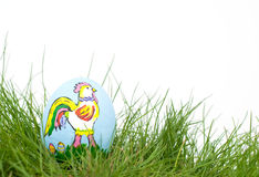 Colorful Easter Rooster hand painted on an egg she Stock Photo