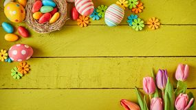 Colorful Easter still life with eggs and flowers royalty free stock image