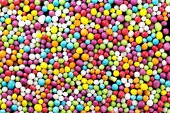 Colorful eatable sugar pearls for food decoration. Useful for a sweet background presentation royalty free stock images