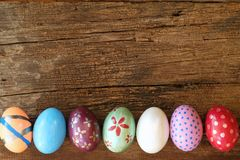Colorful Eater eggs on wooden table. Easter background. Copy space royalty free stock photography