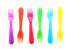 Colorful eating utensils for baby. On white background Royalty Free Stock Photos