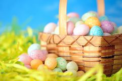 Colorful egg candies on nest Stock Image