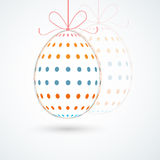 Colorful egg for Happy Easter celebration. Happy Easter celebration with hanging egg decorated by colorful polka dots Royalty Free Stock Image