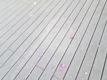 Colorful egg shells and paper confetti on wood deck. Colorful cracked egg shells and paper confetti on wood deck stock photography
