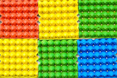 Colorful egg trays background Royalty Free Stock Images