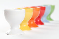 Colorful eggcups. Close-up of a row of colorful eggcups. Shallow dof Royalty Free Stock Images